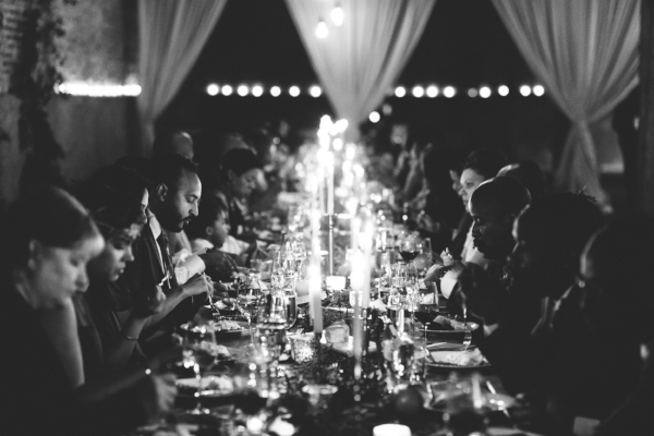 family style wedding dinner reception at one long farm table