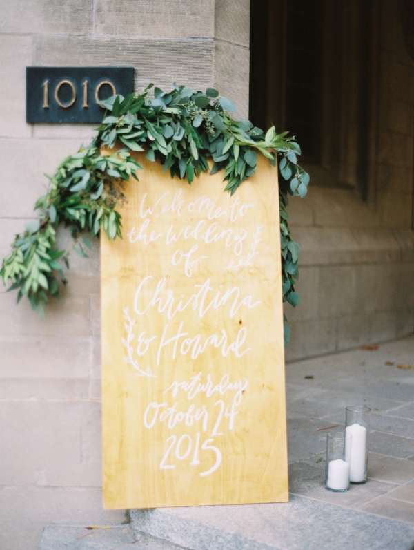 Handlettered calligraphy wedding welcome sign with greenery garland by Foraged Floral
