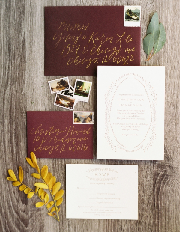 handlettered calligraphy wedding envelopes with vintage art stamps, paired with a simple letterpress invitation by minted