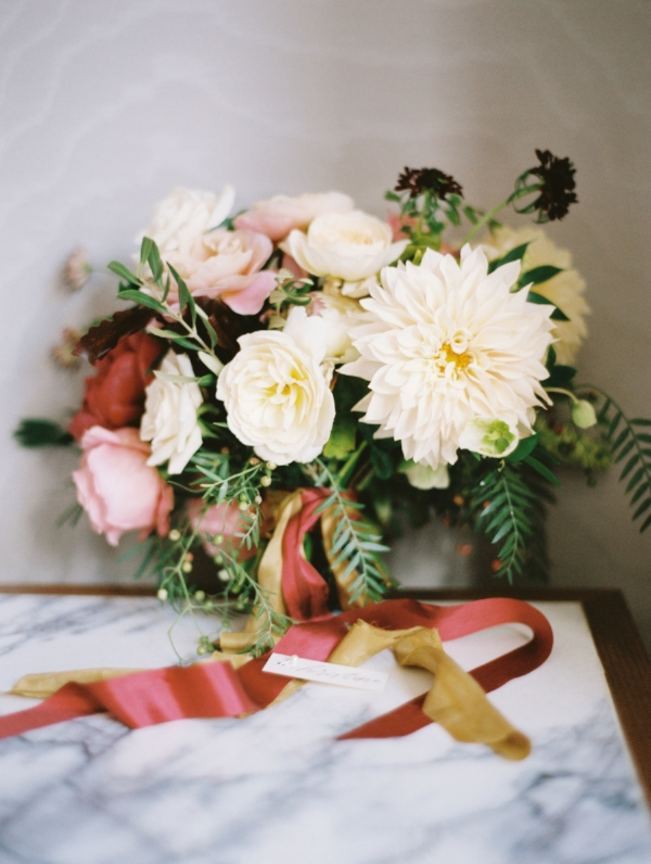 bridal bouquet by Foraged Floral in peach, pink, ivory and burgundy with peonies, dahlias and garden roses with matching ribbons