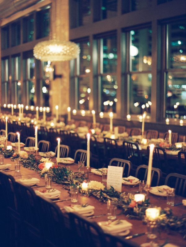 cozy indoor, autumn wedding farm tables with garland, fall fruits and peach, pink, cream, and burgundy flowers such as peonies, dahlias and garden roses by Foraged Floral in Portland, Oregon