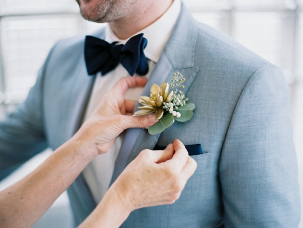gold succulent wedding boutonnieres with winter textures by Foraged Floral in Oregon