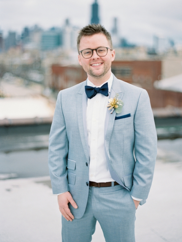 Sophisticated and classic groom's fashion for wedding in grey suit with gold succulent boutonniere by Foraged Floral