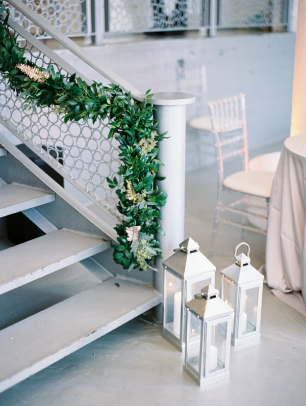 Unique wedding decor for indoor winter wedding at Room 1520 in Chicago with wedding garland by Foraged Floral