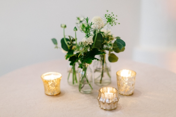bud vases filled with greenery and white flowers by Foraged Floral in Portland, Oregon