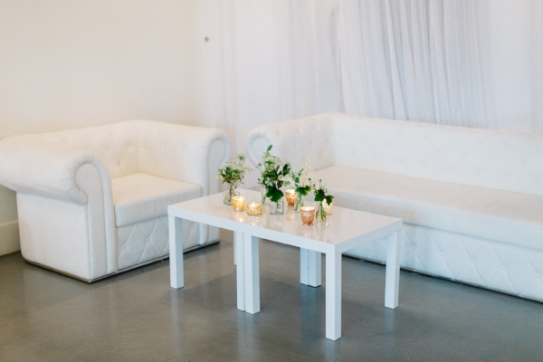 Wedding lounge area decor with candles and flowers by Foraged Floral