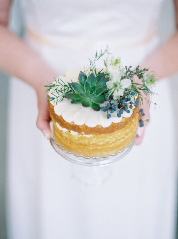 Mini naked wedding cake topped with fresh white and green florals and a succulent by Foraged Floral in Portland, Oregon