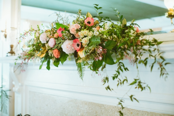 coral, pink, blush and gold wedding flowers on fireplace mantle in Portland, Oregon by Foraged Floral