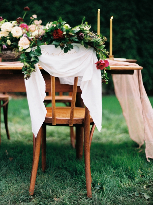 Flowers and greenery on bride and groom wedding chairs by Foraged Floral for Seattle, Washington wedding