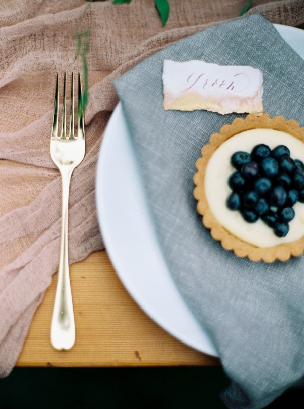 french inspired wedding placesetting with calligraphy escort card