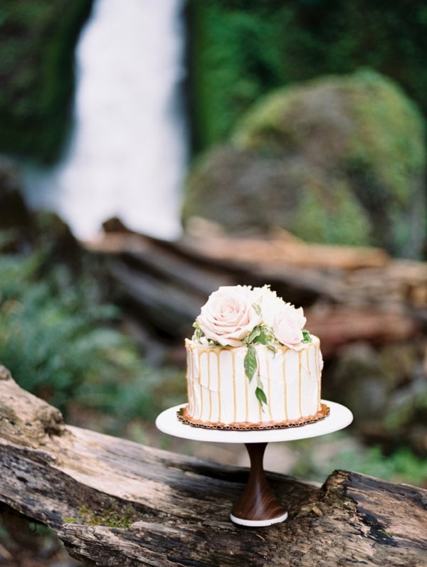 white wedding cake with pink and white flowers on top for Oregon wedding by Foraged Floral