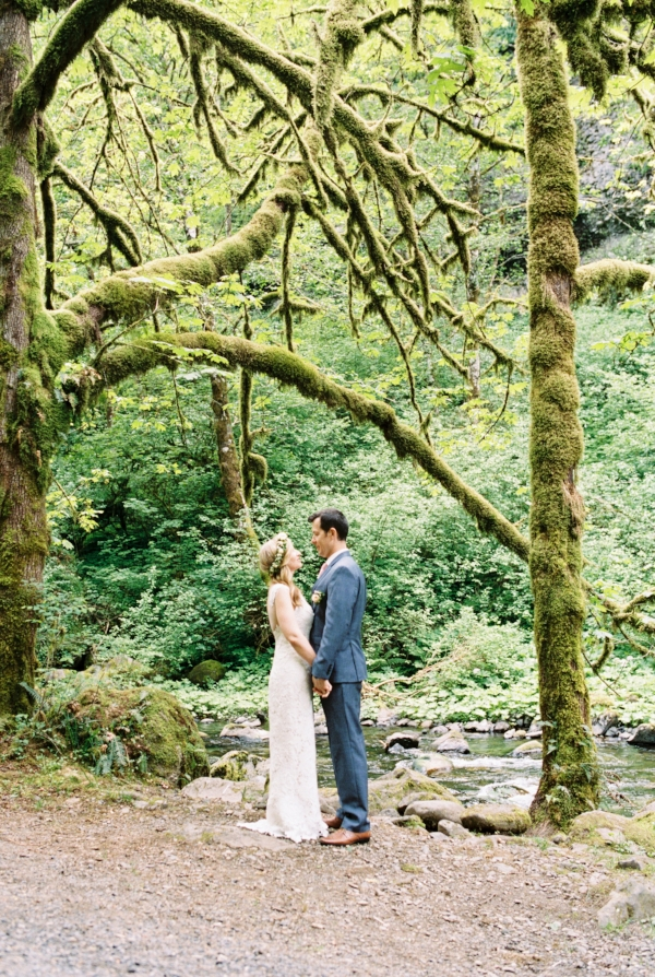 Spring adventure elopement at Wahclella Falls with pink, peach and white wedding bouquet full of peonies, ranunculus and garden roses by Foraged Floral in Oregon