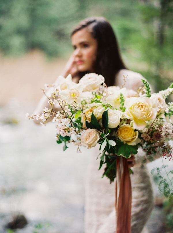 Spring pastel bridal bouquet with peach, pink and yellow flowers like garden roses, spirea, and daffodils by Portland, Oregon Wedding Florist - Foraged Floral