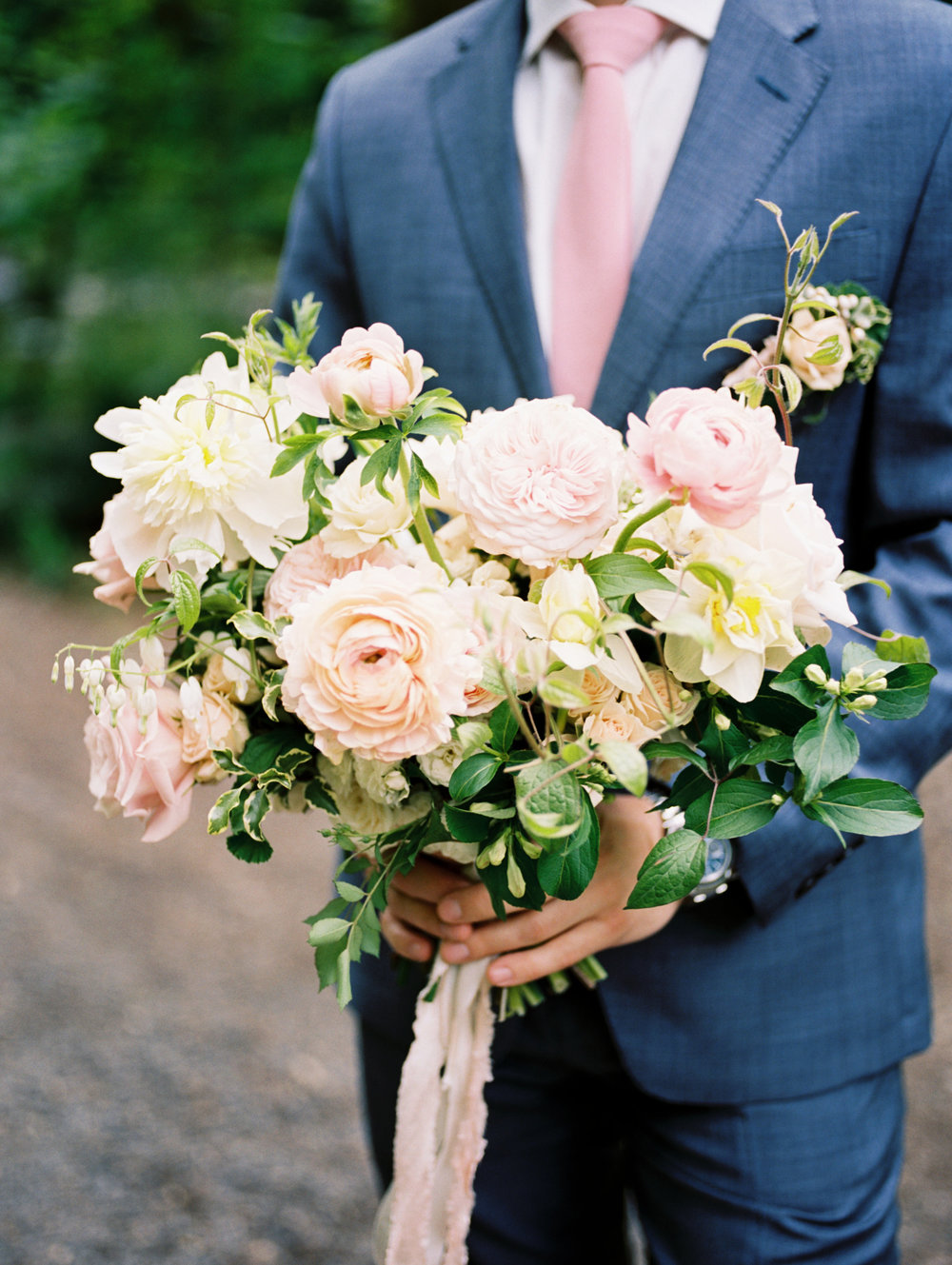 spring wedding bouquet with ranunculus and peonies.JPG