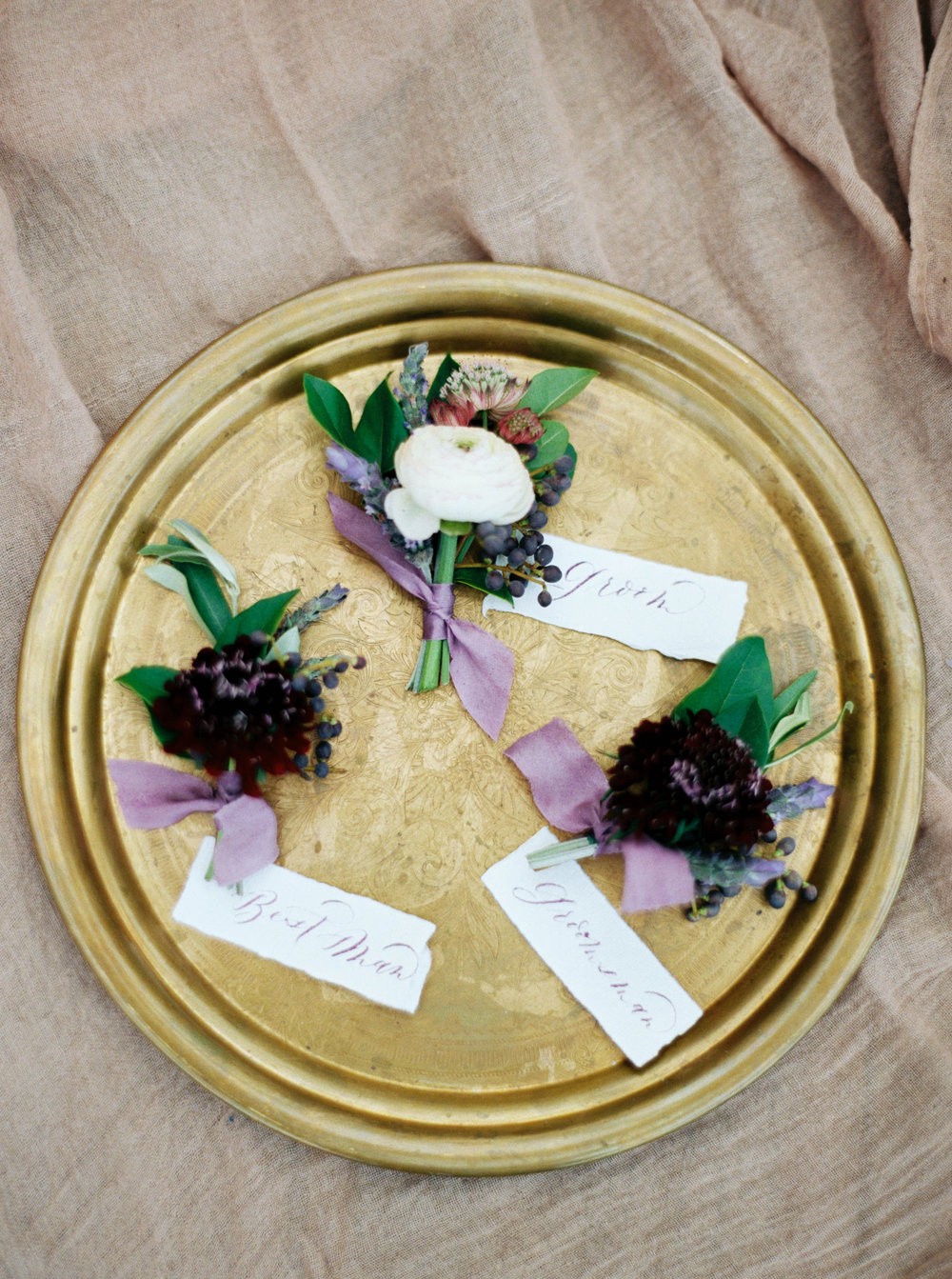 purple and white boutonnieres.JPG