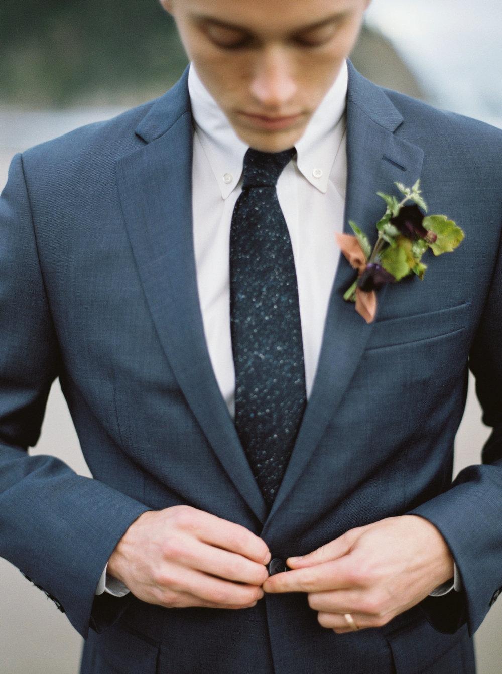 dark purple boutonniere for beach wedding.jpg