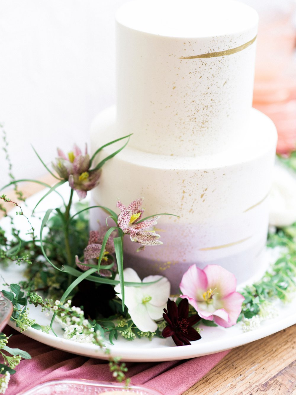 spring wedding flowers on white and purple cake.jpg
