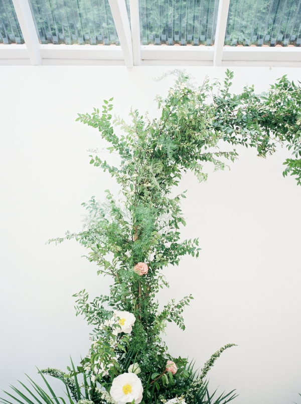 Wedding arch with greenery, peonies and mauve garden roses by Foraged Floral