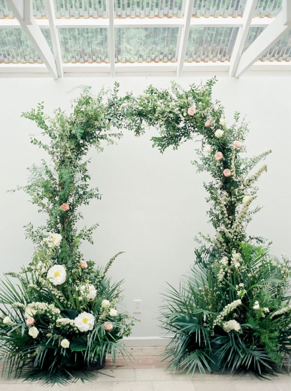 Wedding arch with greenery, peonies and garden roses by Foraged Floral
