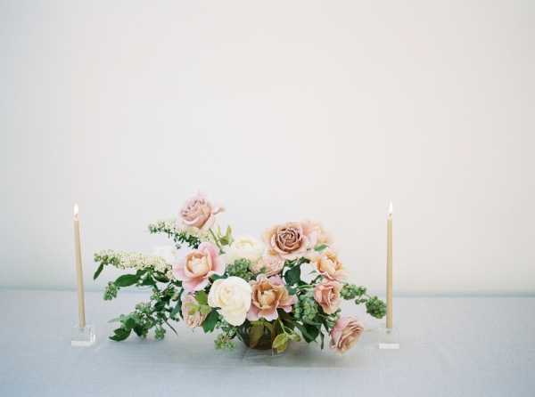 Spring wedding centerpiece with mauve, pink and peach flowers such as garden roses and spirea by Foraged Floral