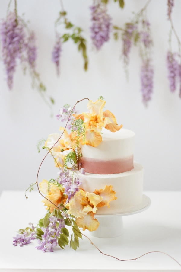 Unique wedding cake inspiration with purple and peach fresh flowers by Foraged Floral