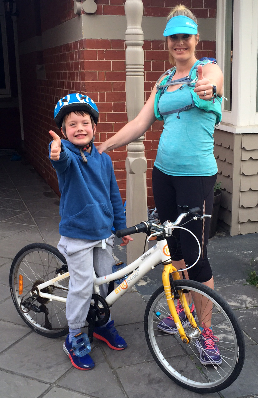 Katherine and her son preparing for a run/ bike ride.
