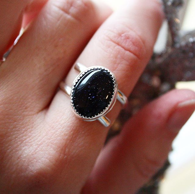 🌟SURPRISE LISTING🌟 Link in bio! Blue Goldstone Wrap Me Up ring, LOOK AT THAT SPARKLE! It's like a tint galaxy in there! A beautiful deep navy with stars abound, reminds me of this winter solstice night sky! Snatch her up quickly before she's gone! . . .Cabochon by my girl @lorelei.lapidary . #ladysmith #silversmith #gift #jewelry #christmas #holidays #wintersolstice