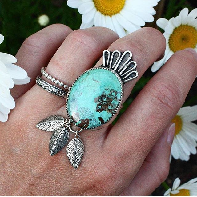 """#throwback 🙌🏻 Does anyone else remember """"The Nomad""""?! Oh, I loved this piece so much, and the gorgeous chrysocolla that it featured. ☀️ With spring here and lots of rainy Maine days, I've been having the itch to get to the bench more than ever! Nothing like a rainy day, a hot cup of coffee, some good tunes, and some time making pretty jewels with heat and dirty tools!!! 🙈 I'm fully committed to not smithing while pregnant though — probably mostly because dealing with infertility makes you crazy and not willing to take on anything even remotely iffy — but GET THIS GUYS!!! I will be #21weekspregnant 🤰🏻 on Tuesday! So we are over halfway there! I am so, so excited! 🌈💙🥰 Before we know it, I'll be back at the bench! I miss you all so much!!!! 🙌🏻🙌🏻🙌🏻🙌🏻 PS - swipe for a bumpdate from 20 weeks!"""