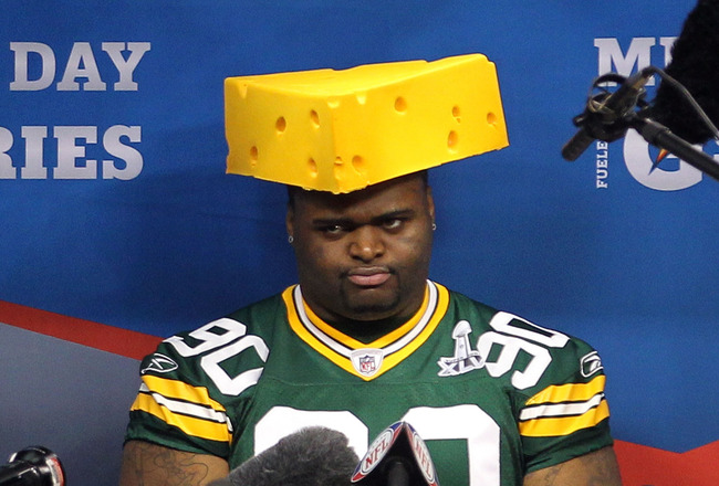 Source: https://thefootbawlblog.files.wordpress.com/2014/03/wearing-cheese-head.jpeg