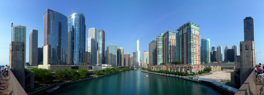 Source: https://upload.wikimedia.org/wikipedia/commons/e/e8/20090524_Buildings_along_Chicago_River_line_the_south_border_of_the_Near_North_Side_and_Streeterville_and_the_north_border_of_Chicago_Loop,_Lakeshore_East_and_Illinois_Center.jpg