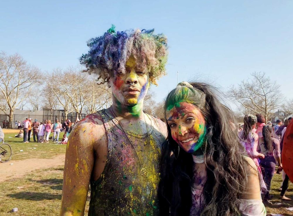 Leo Henry  and  Tara Lynn Faith  playing with colors at Holi Festival in Queens.