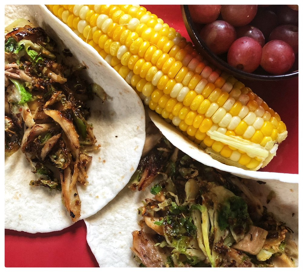 Shaved cauliflower, grilled chicken, vegetables seasoning of choice and a drizzle of honey. Two medium flour tortillas warmed up. Corn on the cob with a cup of grapes on the side (7 WW points)