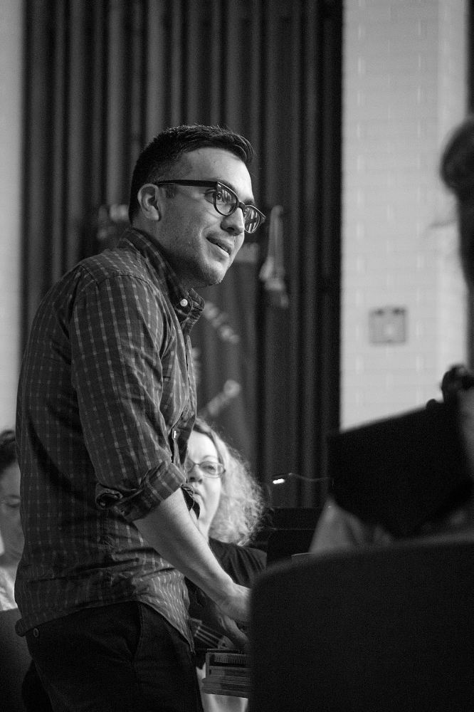 Music Director Ruben Valenzuela in rehearsal.
