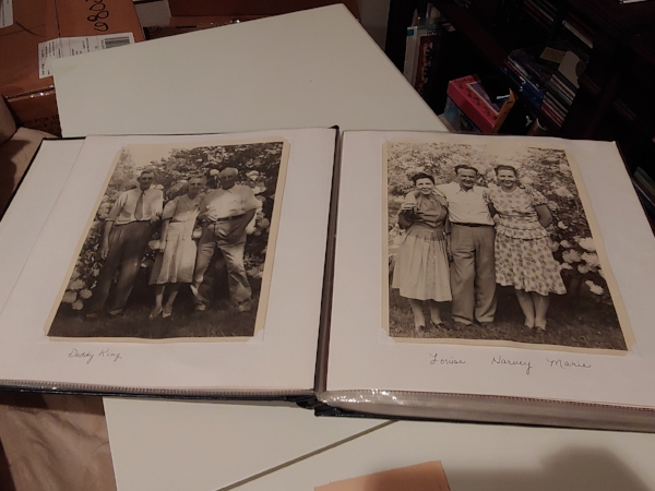 Old family photos in family album. Grandparents and aunts and uncles!