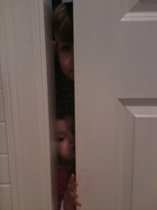 Trying to answer email while hiding in the bathroom, but they found me.