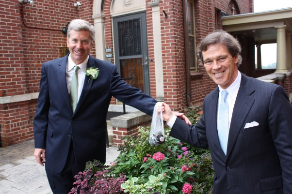 This is one of Dad's best friends meeting him after the ceremony with a celebratory beverage, previously hidden in the flowers outside the church. This is a tradition that dates back to my wedding. Don't ask.