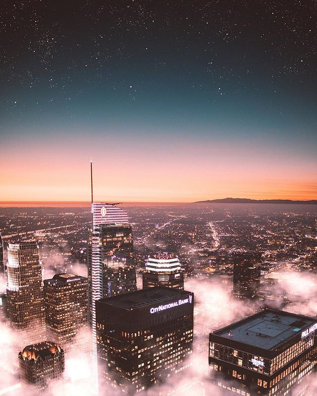 with fog below and stars above, the city was glowing. friends! i'm so excited to be partnering with @photoshop over the next few months to be creating original pieces of content with unique themes. the theme this month is #Ps_Urban and i decided to give the los angeles skyline a touch of magic using @photoshop! #AdobePartner