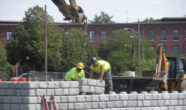 Construction workers building the retaining wall.