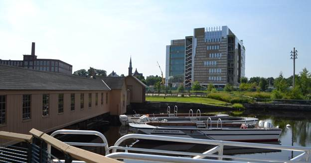 Swamp Locks gatehouse and new Lowell Justice Center under construction.