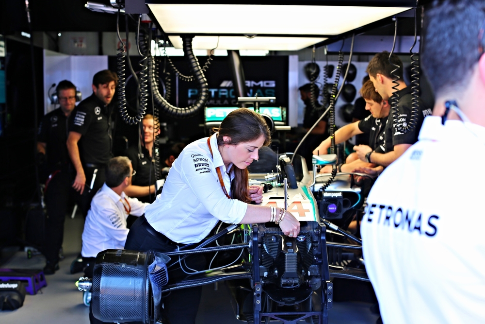 The Mercedes AMG Petronas team building Lewis Hamilton's car before the qualifying race.