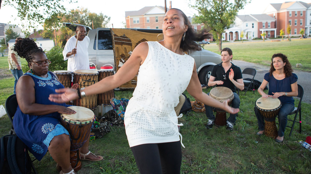 RWJF COH Louisville August 25-28, 2016   Project H.E.A.L. (Health. Equity. Art. Learning.)  drum circle in the Smoketown neighborhood of Louisville, led by drummer Gregory Acker. In this picture, Cynthia Brown dances to the beat of the group.