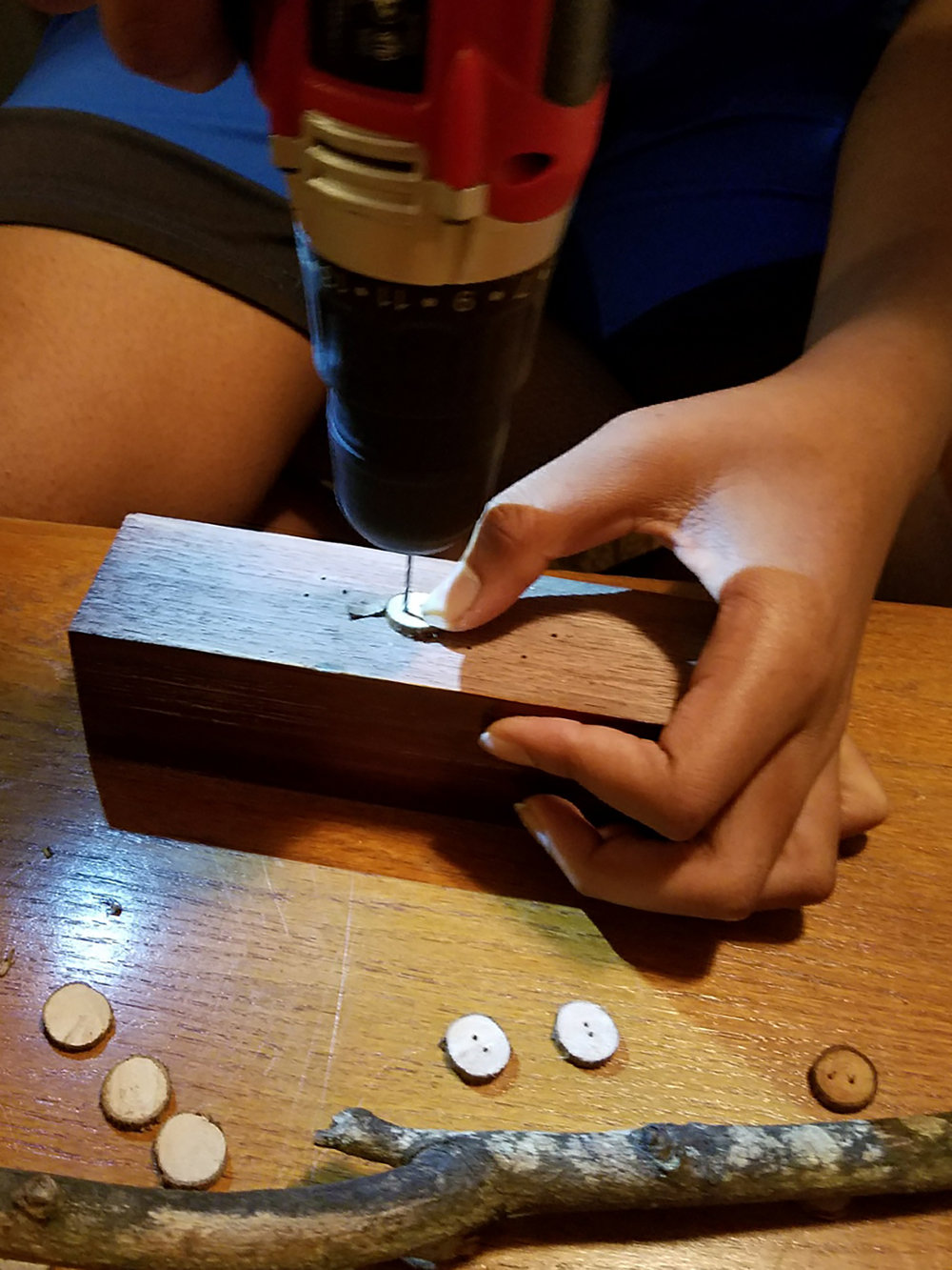 Daniel J. Hartwell carves wood buttons out of magnolia branches to be inserted into bars of Button Soap. Photo provided by Johnnie and Loraine Griffin.