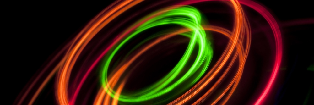 concentric circles of light: green, red, and orange