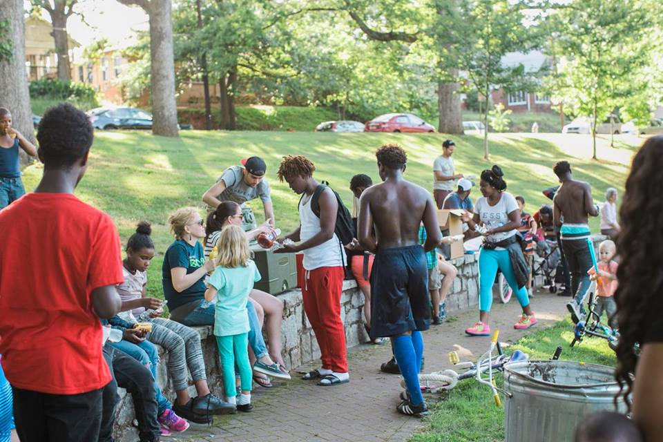True North Community Church in Atlanta, GA, serving food to the surrounding community outdoors in a park.