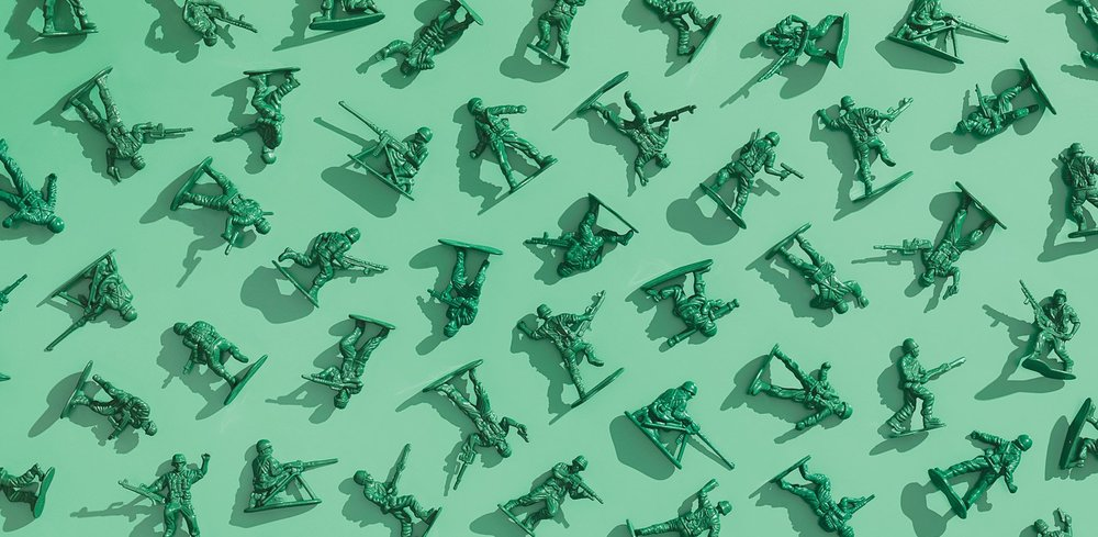 a series of green army men laid down in a pattern