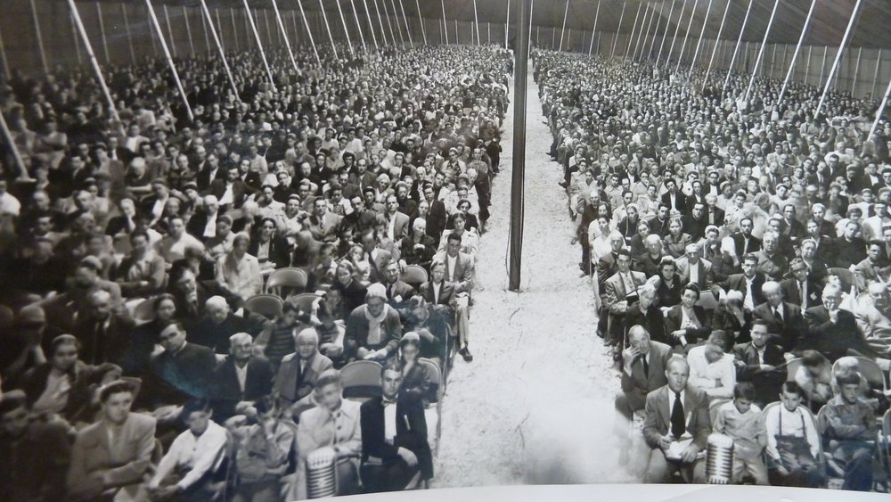 Tent revival from the 1920's or 1910's represented in a black and white picture