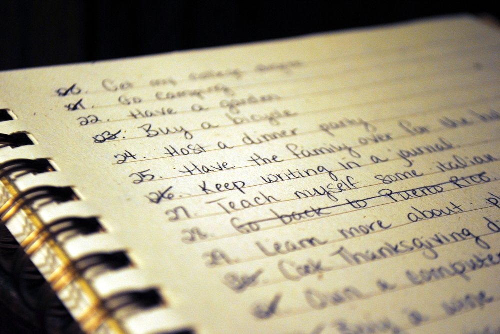 close up of a bucket list on a notepad with writing
