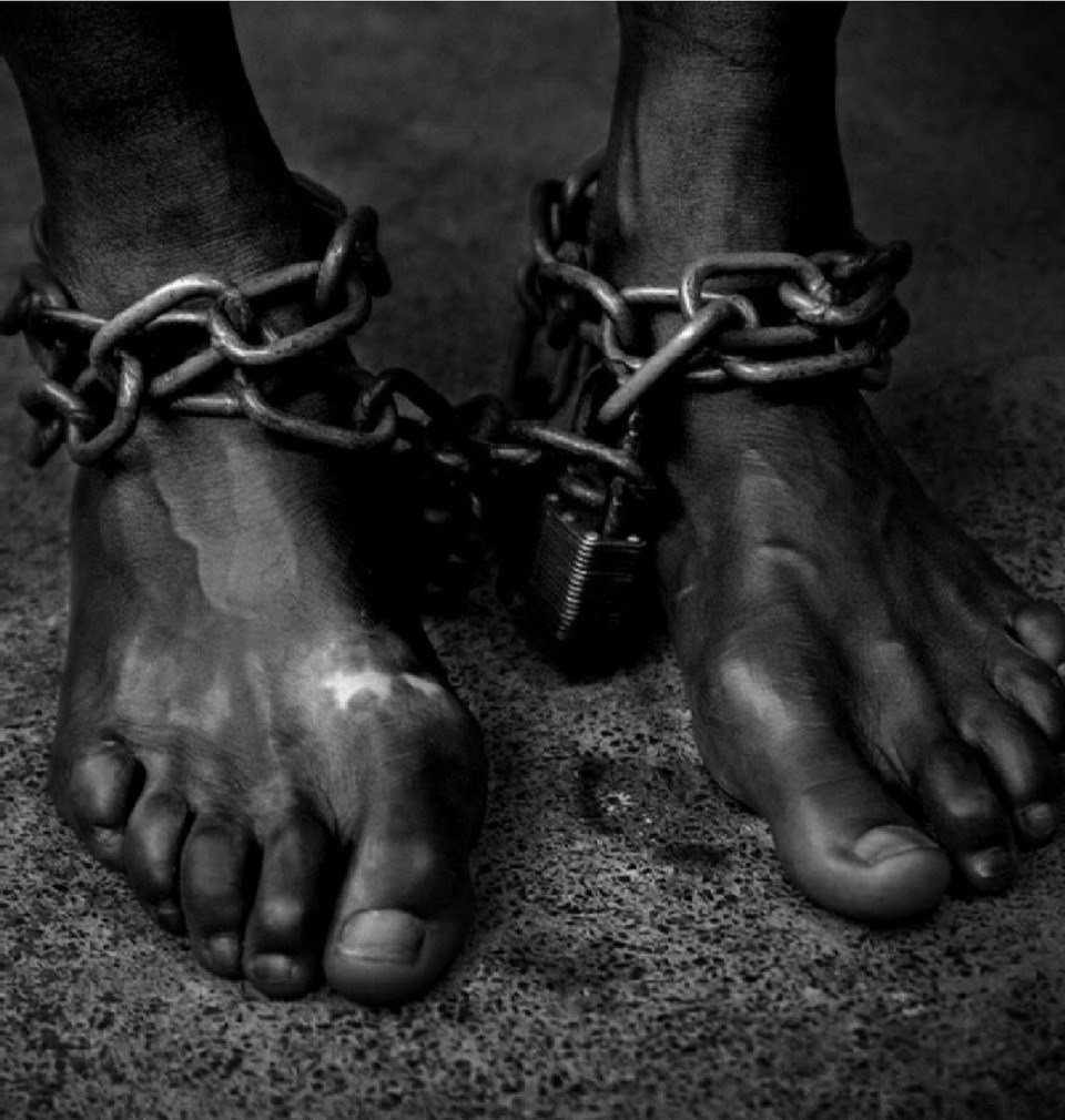 Slavery symbolized by two feet chained together