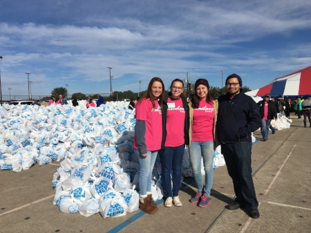Courtney K., Rachel G., Stacie R., and Jon R. helped bag and pass out groceries at The Convoy of Hope Fort Worth Event.