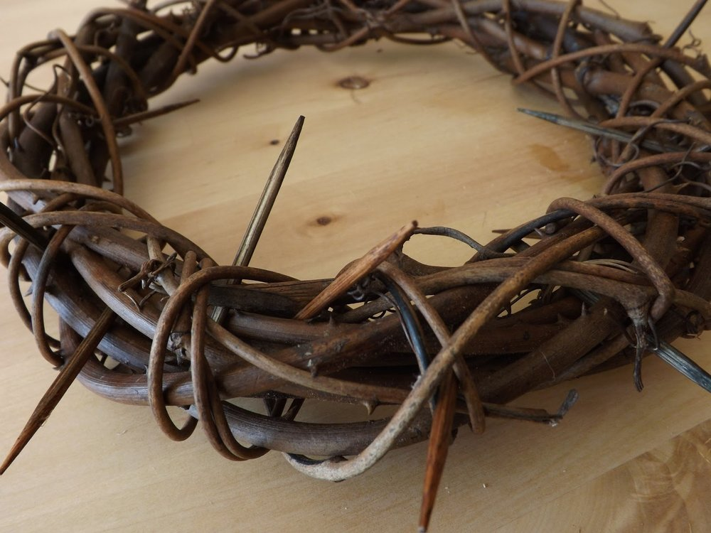 close up of a crown of thorns on a wooden table